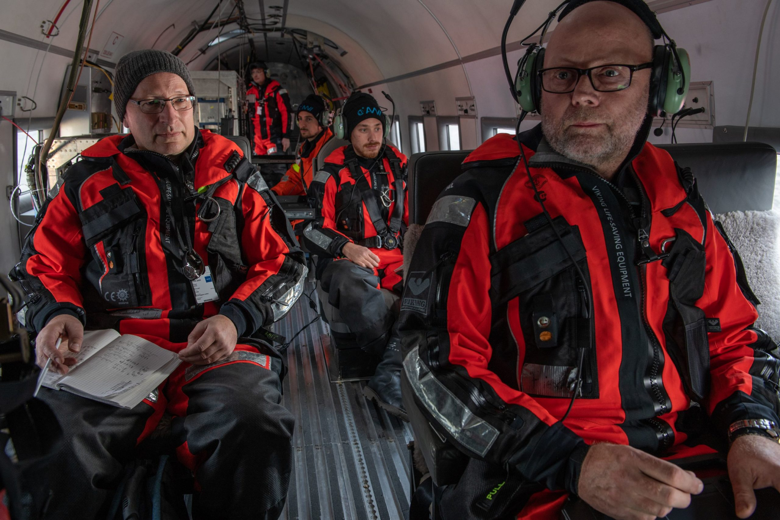 Portrait of Polar 5 atmospheric team during MOSAiC aircraft campaign. From front to back: Friedhelm Jansen (r) , Christof Lüpkes (l) , Manuel Moser, Hanner Probst and Michael Schäfer.